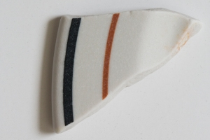 This piece is part of a striped ceramic plate.