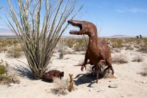 Statue of Nonlocal Utahraptor Dinosaur Guarding Nest of Eggs (Jurassic Era)