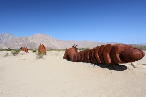 Fanciful 350-foot-long Dragon Serpent with Rattlesnake Tail (road runs through middle of sculpture)