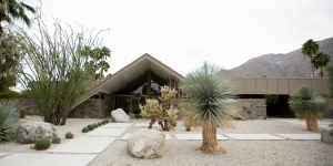 Home's Dramatic Entrance Windows Overlook Desert Landscape