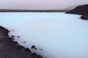 Blue Lagoon's Milky Blue Water within Black Volcanic Landscape