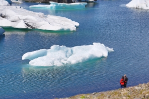 Couple Viewing Icebergs in Lagoon