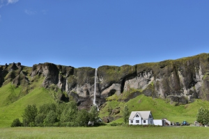 Waterfall and Farm in South Iceland