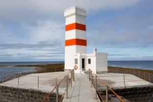 Older Red and White Striped Gardskagaviti Lighthouse