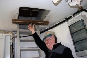 Richard Unlocking Trapdoor Bolt to Top of Tower