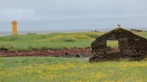 Gerdistangi Lighthouse on Private Property Behind Old Stone Wall.  Reykjanes Peninsula near Reykjavik.