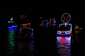 Colorful Boat Parade in Canal