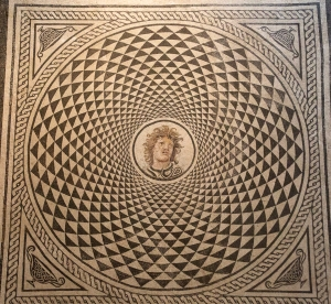 Mosaic Floor's Spinning Shield Motif with Head of Medusa in Center