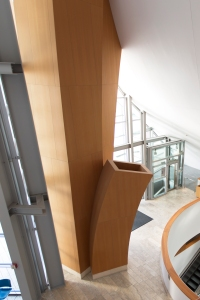 Lobby's Wooden Support Columns Mimic Trees (designed to hide structural/mechanical equipment)