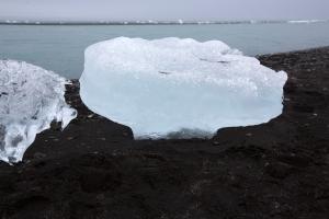 Iceberg on Black Volcanic Sand