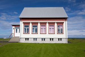 Colorful painted design on traditional house beside Utskalakirkja