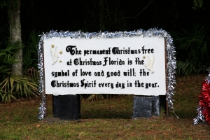 Sign Beside Christmas Tree